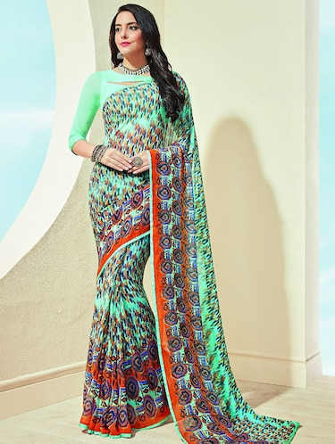 abstract printed turquoise saree with blouse - 15475202 - Standard Image - 1