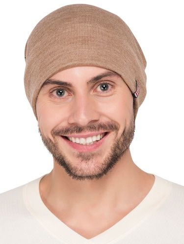 beige wool caps and hat - 15498069 - Standard Image - 1
